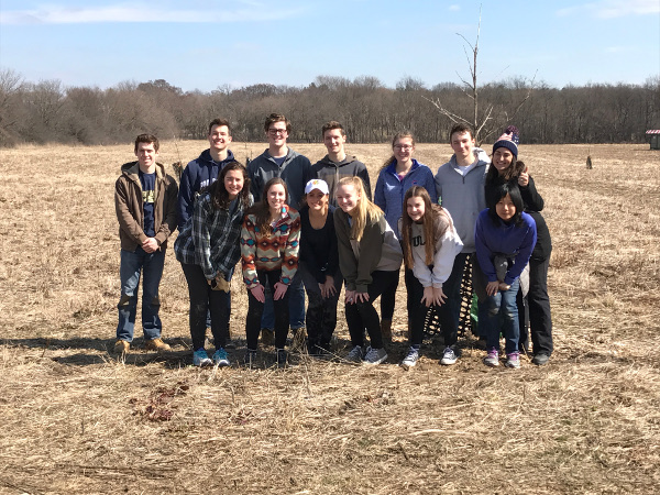 On Sunday March 19th, 2017, the Youth Advisory Council worked with Restoration Technician Chris to cut and burn buckthorn in the Far Field - acreage donated to create an Oak Savannah. Pictured are Kate Ahern, Drew Douglas, Ryan Boundy, Jake Mitchell, Elise Burns, Fiona Nyland, Pelle Gierlach, Mark Nicoletti, Olivia Wink, Ally Ahern, Eden Solberg.